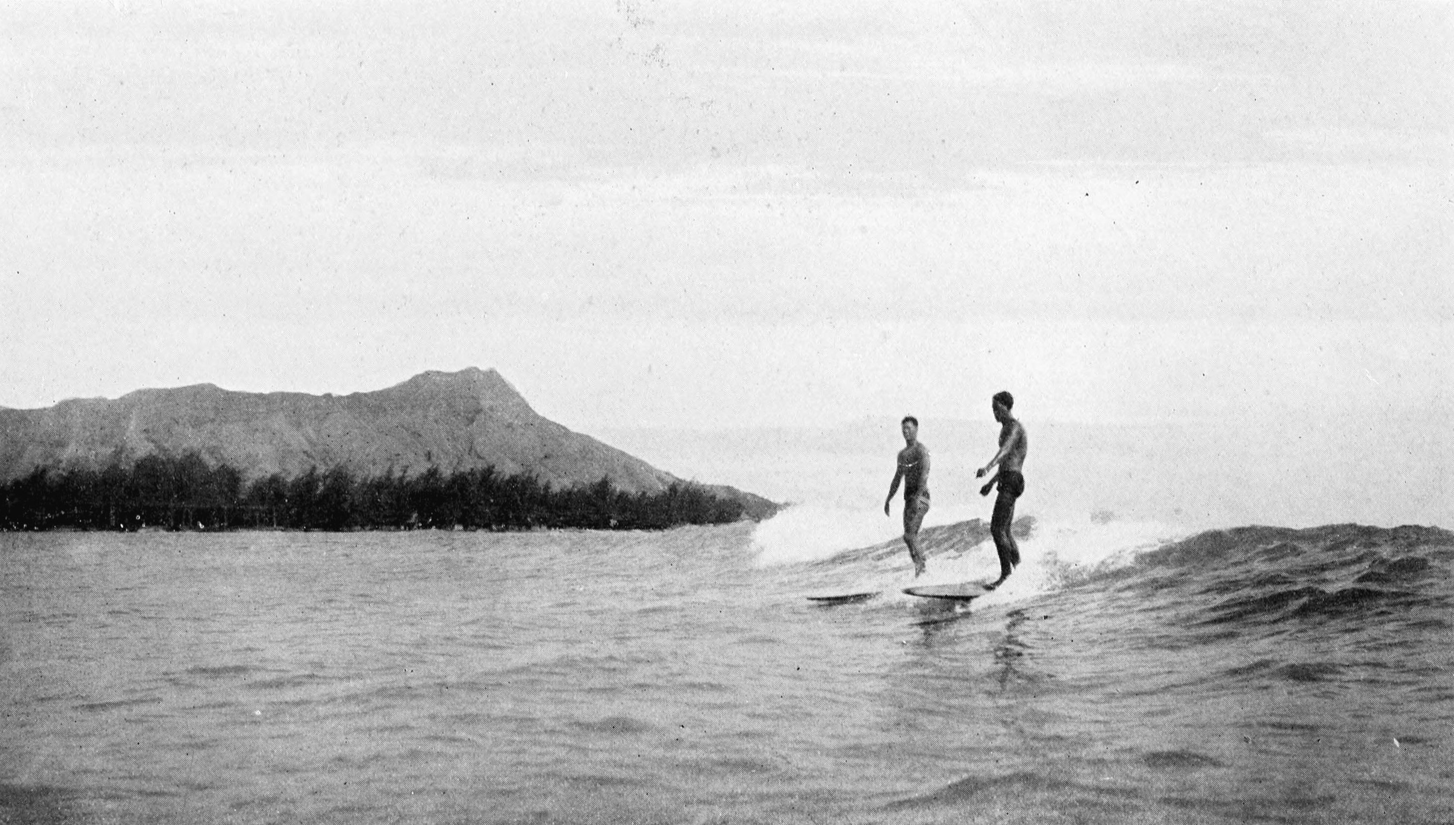 [Surfing at Waikīkī, 1921] At the left is Diamond Head. From Collier's New Encyclopedia.