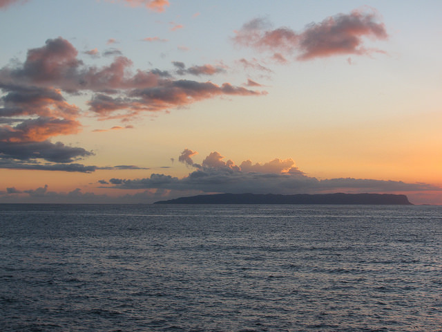 [Niʻihau at sunset] Photo by Forest & Kim Starr.